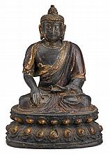 Chinese parcel gilt bronze seated Buddha, ming period, Seated in vajrasana with his right hand in the earth-touching mudra, his robe ad