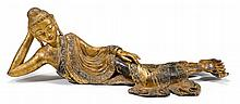 Burmese gilt wood reclining Bodhisattva, , Mandalay style, borders of the robe inset with glass roundels.