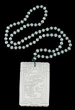 Chinese white jade pendant on beaded chain, qing dynasty, Archaic scrolls on top and bottom border surrounding a rectangular front pane
