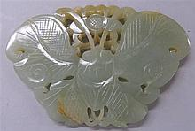Chinese celadon jade butterfly form pendant, , Pierce carved as a butterfly and a flower.