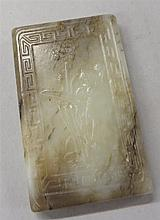 Chinese mottled jade rectangular pendant, 20th century, Keyfret frame, a lotus on front and four Chinese characters verso.