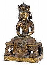 Sino-tibetan gilt bronze figure of Amitayus, qianlong mark and of the period, Seated on raised platform wearing crown headdress, traces