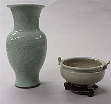 Two Chinese celadon glazed porcelain items, qing dynasty and earlier, Including a longquan style baluster vase moulded with flowers and