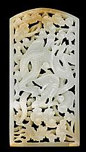 Chinese white jade reticulated 'dragon' plaque, qing dynasty, One-sided plaque pierce carved with a coiled dragon among scrolling ruy