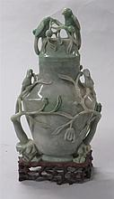 Chinese jade vase and cover, , Ovoid vase openwork carved with birds among fruiting peach, citron and flower sprays