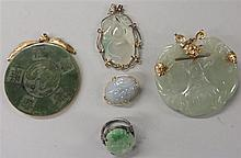 Group of Chinese jade jewelry items, , including a double gourd pendnat, a lock form pendant, a 'fu lu shou kang ning' circular penda