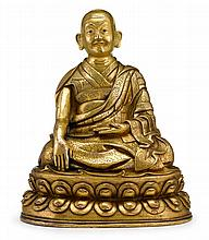 Sino-Tibetan gilt bronze figure of a luohan, qing dynasty, The holy figure with close-cropped hair and bearing a pleasant expression in