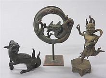 Three bronze objects, , Including a qiling, a circular dragon, and a demonic figure.