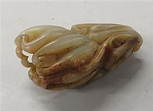 Chinese russet jade citron carving, qing dynasty, Carved in the form of two citron fruits hanging from the vine, jade with russet and s