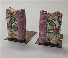 Two Chinese famille rose porcelain book ends, late qing dynasty, Scroll form pen holder mounted as metal book end, puce enameled to hal