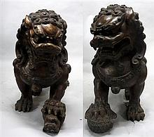 Pair of Chinese gilt bronze fu lions, modern, Buddhist lions sitting upright, one with a ball and one with a cub under front paw.