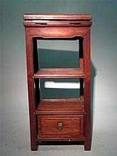 Chinese hongmu jardinere, 19th century, Tall stand fitted with brass interior and hardwood cover and shelf over drawer.