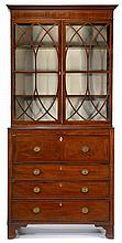 Federal inlaid mahogany secretary bookcase, circa 1800, In three parts, molded cornice above bookcase with inlaid mullioned glazed door