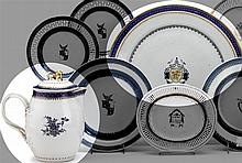Chinese Export porcelain pseudo-armorial circular charger, circa 1800, The reserve painted with central shield filled with floral branc