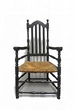 Black-painted bannister back armchair, late 18th century, Arched crestrail above four molded bannisters joined by turned stiles, shaped