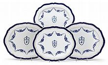 Two pairs of Chinese Export porcelain pseudo-armorial platters, circa 1800, Each of oval form with scalloped rim, the reserves painted