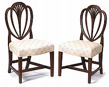 Pair of Federal mahogany shield-back side chairs, circa 1800, Molded heart-shaped back on overupholstered serpentine front seats and mo