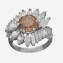 A colored diamond, diamond and platinum ring,