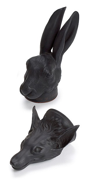 Two English black basalt stirrup cups, 18th century, in the manner of wedgewood and bentley, The first in the form of a hare's head, t