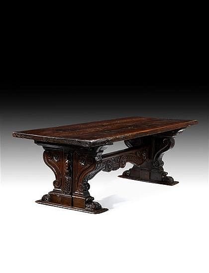 Impressive Italian walnut refectory table, 17th/18th century, The large planked rectangular top over two boldly carved scroll supports