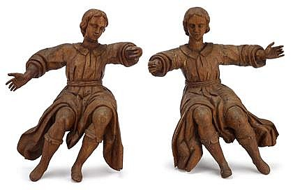 Pair of Continental carved chestnut figures of angels, early 18th century, Carved in near mirror images, with flowing dresses and arms