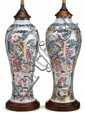 Pair of Chinese famille rose vases mounted as lamps, the porcelain 18th century, Slender baluster form, decorated to show two large res