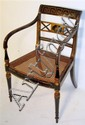 Regency ebonized and parcel gilt armchair, circa 1810, The Greek key painted toprail above channel molded downswept arms, flanking cane