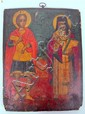 Eastern Orthodox painted icon, 18th century, possibly earlier, The slightly curved panel painted to show St. George holding a cross and