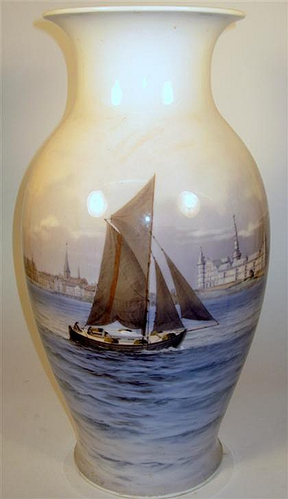 Royal Copenhagen blue and white porcelain vase, 20th century, Baluster form, painted to show a sailing boat at sea, with architecture i