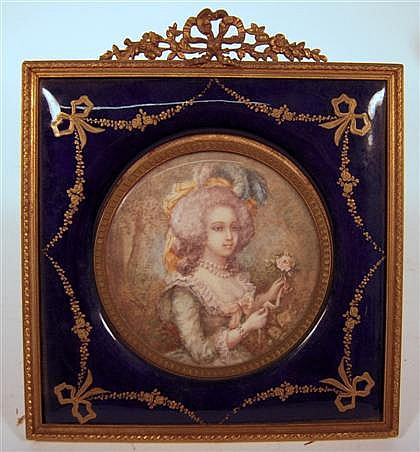French portrait miniature on ivory, 19th century, Circular form, depicting a lady holding a rose, within a gilt metal and cobalt enamel