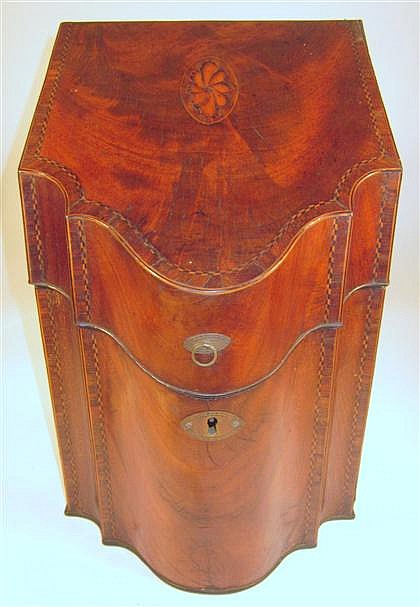 George III inlaid mahogany knife box, late 18th century, The sloped serpentine lid inlaid to show a shell, opening to a fitted interior