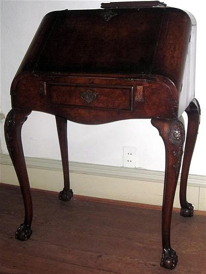 George I mahogany writing desk, early 18th century and later, The shaped top with hinged drop-down writing surface flanked by two lift