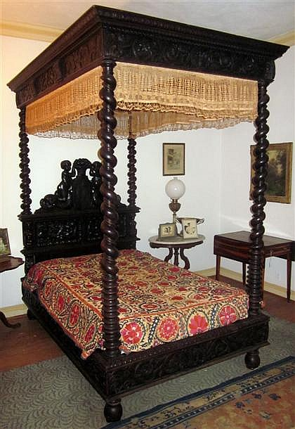 Renaissance revival carved oak bedstead, , The large headboard carved to show putti with lions, flanked by caryatids, the rails carved
