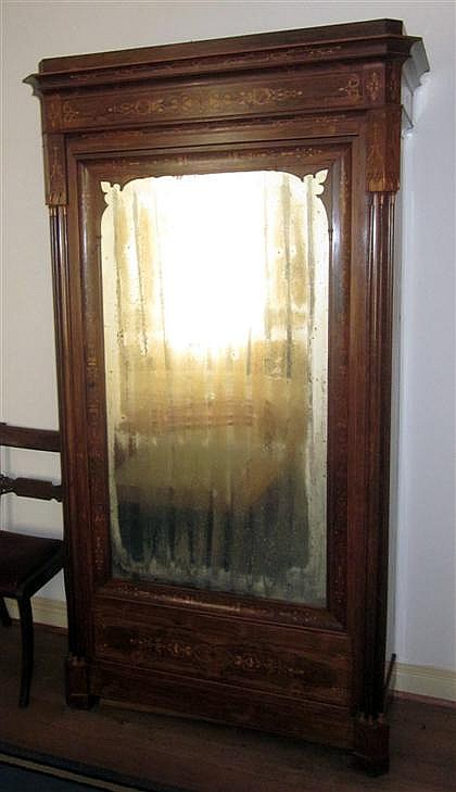 Charles X marquetry inlaid rosewood linen press, circa 1850, The molded and inlaid cornice over single mirrored door flanked by quarter