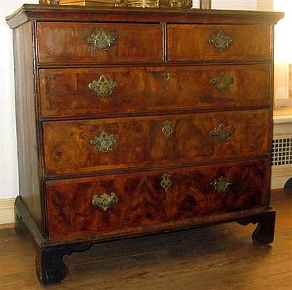 George I burl walnut crossbanded chest of drawers, early 18th century, The rectangular quarter-veneered top over two short and three gr