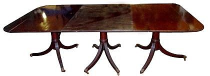 Regency style triple pedestal mahogany dining table, late 19th century, The rectangular top with two leaves, reeded edge, the three rin