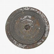 A large Chinese silvery bronze circular mirror, han dynasty