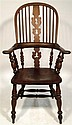 English elm windsor chair, 19th century, The spindle back over horseshoe arms, above turned supports and shaped seat, raised on turned