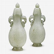 A pair of Chinese celadon jade twin handle covered vases, modern