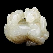 A Chinese carved celadon jade toggle, 19th century