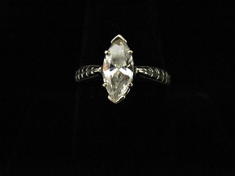 A diamond and fourteen karat white gold ring aux enchères