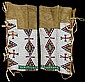 Sioux women's beaded leggings, early 20th century, Beaded with green, red, blue and white geometric devices.
