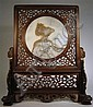 Chinese carved wood and inset dali stone table screen, 19th century, The elaborately-carved, openwork stand and screen frame a circular