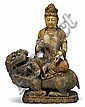 Large Chinese giltwood bodhisattva, ming dynasty, The large figural grouping shows Quanyin in typical attire seated upon a recumbent fu