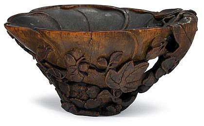 Chinese carved rhinoceros horn libation cup, 17/18th century, Typical out-line, well carved beaded leaf rim over vine and berry lattice