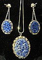 14 karat yellow gold and lapis pendant and earrings, , Foliate carved lapis in gold border.