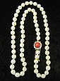 Single pearl strand with coral clasp, , Average pearl size 7.8mm, coral clasp with seed pearl surround.