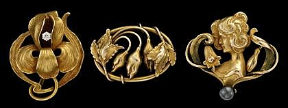 Group of three Art Nouveau 14 karat yellow gold pins, , One of female form featuring hematite bead, one floral design, and one 'Iris'