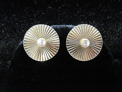 Pair of 14 karat yellow gold and pearl earrings, 20th century, Circular ribbed discs, each set with a single small pearl, screw clip ba