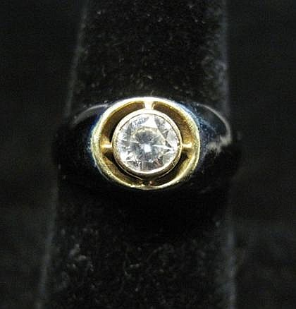 14 karat yellow gold, enamel and diamond ring, , Round cut diamond approximately .50 carats, bezel set in black enameled gold mounting.